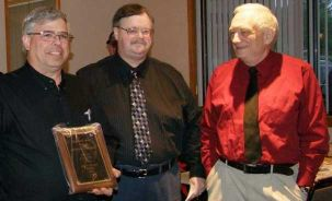 Don McLain KB8RAD and Bob Berger K8RDN congratulating John Hosford KC8QZB, the 2012 Ziegenbein Award Winner.